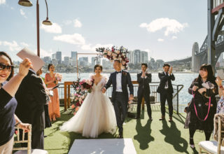 Wedding ceremony on the pier at Pier One Sydney wedding, Photo by Kevin Lue Photography