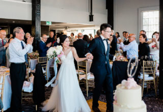 Couple entering their wedding reception at Pier One Sydney Harbour Water Room, Photo by Ballyhoo Photography