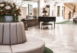 Hotel Savoy on Little Collins foyer with grand piano and lounge