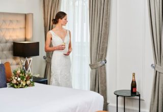 Bride getting ready on wedding day at The Savoy Hotel on Little Collins