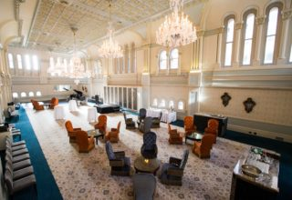 Room overview of the Tea Room QVB with high ceilings and big chandeliers