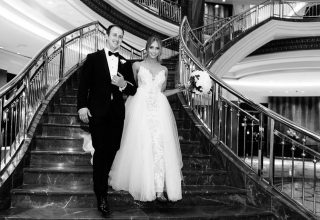 Couple on staircase at Park Hyatt Melbourne wedding, photo by Erin & Tara
