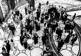 Cocktail hour in the foyer at Park Hyatt Melbourne wedding, photo by Erin & Tara