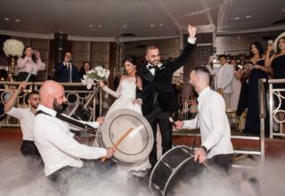 Bride and groom on dancefloor with drummers at Park Hyatt Melbourne wedding