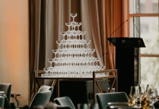 Champagne tower at Metropolis luxury wedding venue in Melbourne, photo by Miranda Stokkel
