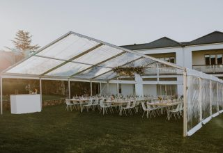 Tent at Chateau Yering sunset magic hour, Yarra Vallery winery wedding venue, Photo by Elsa Campbell