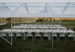 Marquee overlooking Yarra Valley vineyards for sunset wedding, Photo by Elsa Campbell