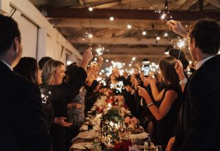 Gather & Tailor -Gather-Tailor-wedding-reception-dinner-tables-upstairs-sparklers-toast-Photo-by-Georgia-Verrells.jpg