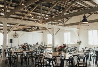 Gather & Tailor -Gather-Tailor-wedding-reception-dinner-setup-round-tables-upstairs-Photo-by-Georgia-Verrells.jpg