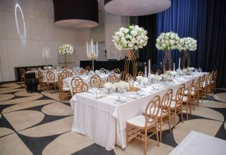 Wedding reception with floral centrepieces at ivy Ballroom by Merivale